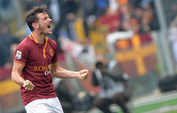 AS Roma's Alessandro Florenzi celebrates after scoring the 1-0 during the Serie A soccer match between AS Roma and Genoa at the Olimpico stadium in Rome, Italy, 12 January 2014.  ANSA/ETTORE FERRARI