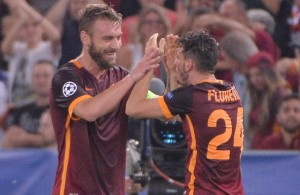 AS Roma's Alessandro Florenzi (R) jubilates with his teammate Daniele De Rossi after scoring the goal during the Uefa Champions League soccer match AS Roma vs FC Barcelona at Olimpico stadium in Rome, Italy, 16 September 2015. ANSA/MAURIZIO BRAMBATTI