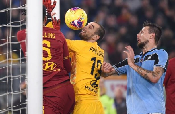 Lazio's Italian defender Francesco Acerbi (2ndR) scores an equalizer despite AS Roma's Spanish goalkeeper Pau Lopez (2ndL) and AS Roma's English defender Chris Smalling (L) during the Italian Serie A football match Roma vs Lazio on January 26, 2020 at the Olympic stadium in Rome. (Photo by Filippo MONTEFORTE / AFP)